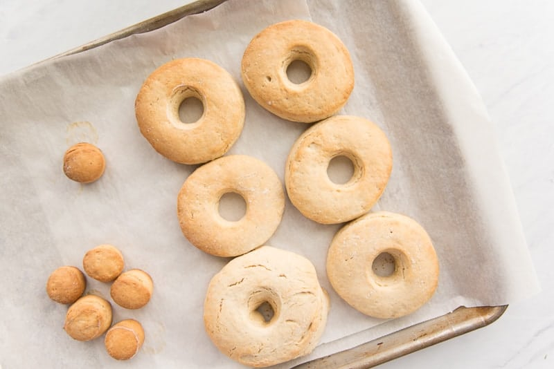 Baked Easy Cake Donuts on a sheetpan lined with parchment paper