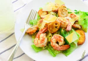 Overhead image of a plate of Grilled Caesar Salad with Shrimp