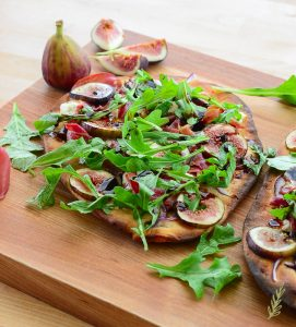 Chèvre & Prosciutto Flatbread topped with Figs and Arugula