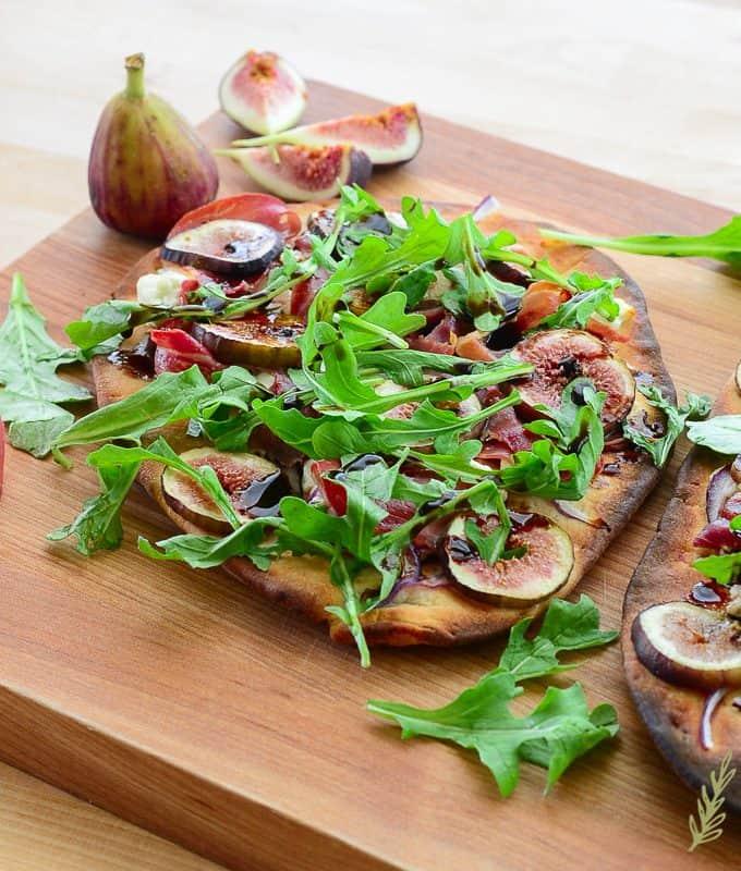 Sense & Edibility's Chèvre & Prosciutto Flatbread topped with Figs and Arugula