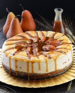 Cinnamon Cheesecake Topped with Spiced Poached Pears and Warm Toffee Drizzle