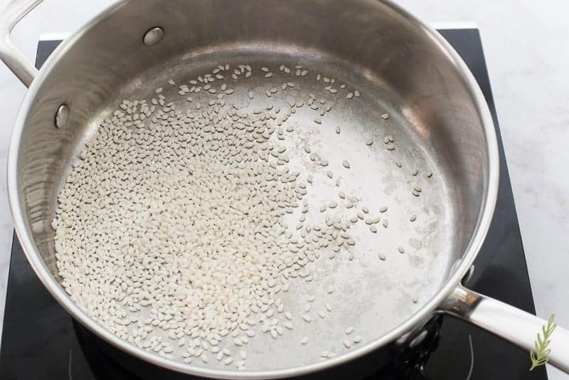 Sticky rice is toasted in a saute pan to brown it