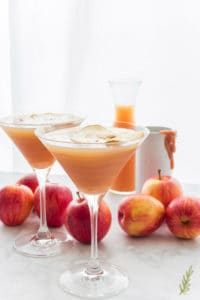 Two martini glasses filled with Caramel Apple Martini