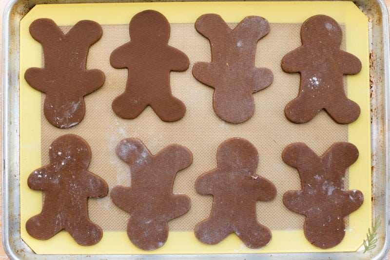 The Gingerbread Reindeer shapes on a silicone baking mat on a sheetpan