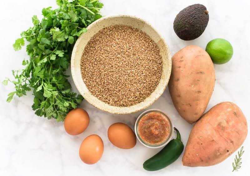 The ingredients needed to make  the recipe cilantro, bulgur, avocado, lime, sweet potatoes jalapeno, salsa, eggs
