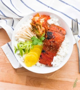 A bowl of steamed rice with Miso-Ginger Salmon