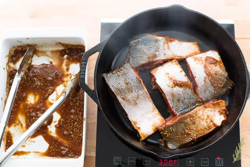 Miso-Ginger Salmon is seared in a cast iron skillet
