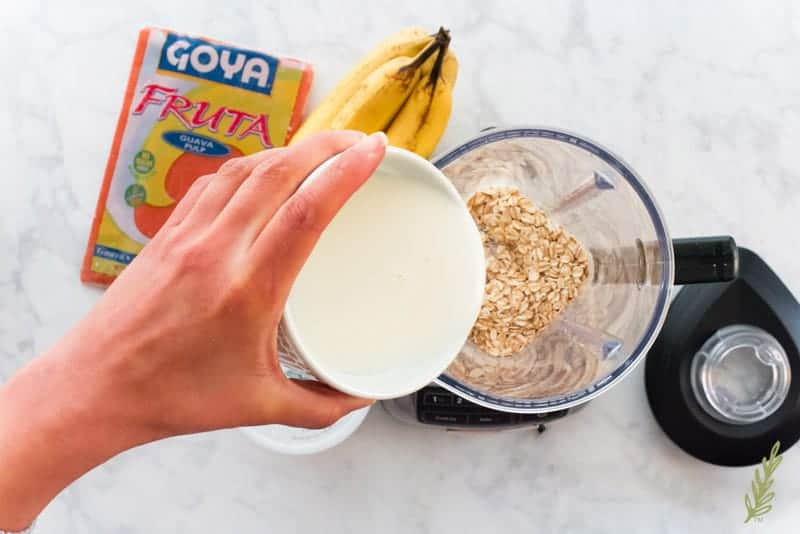 Coconut milk is added to the oats in the blender