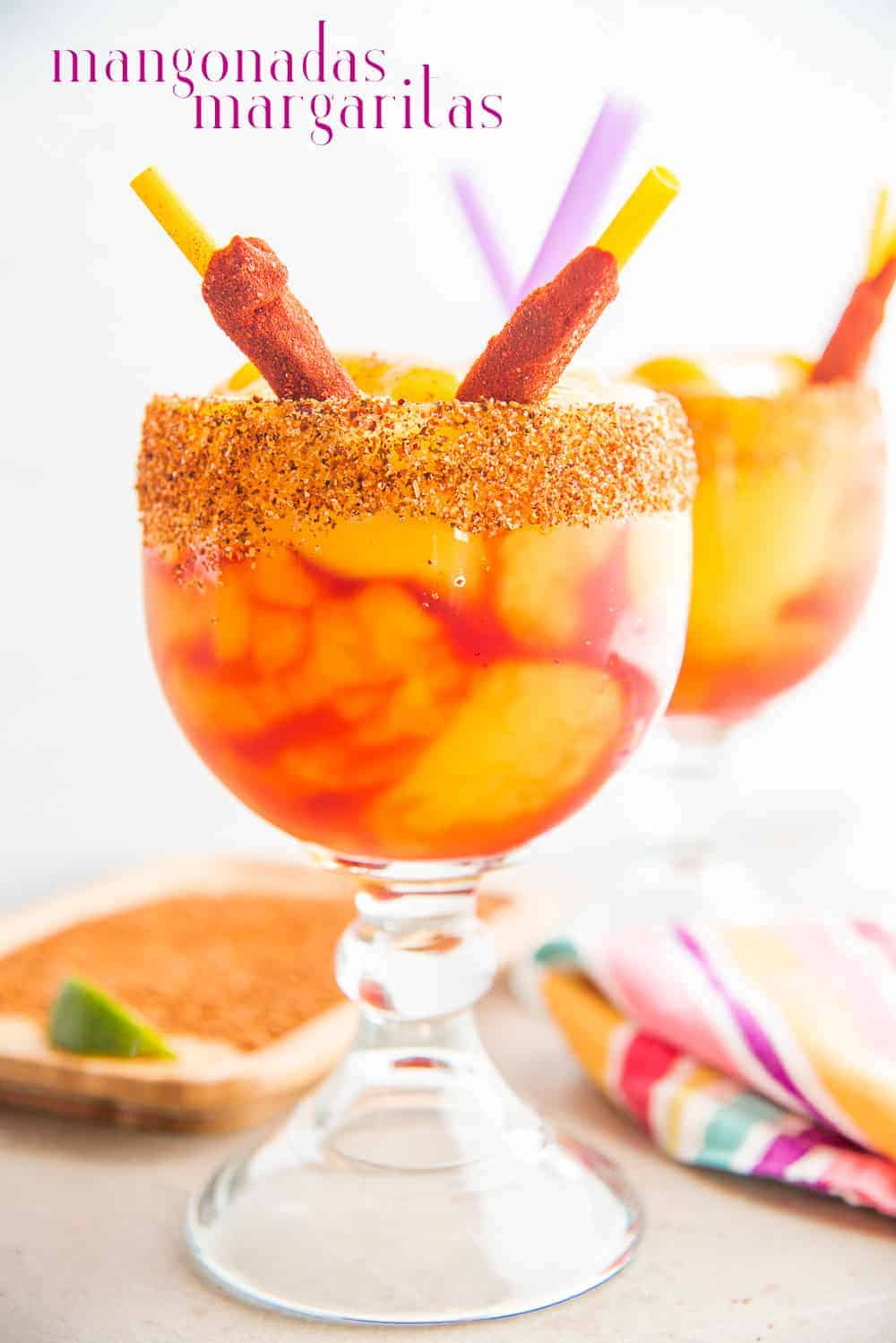Mangonadas are a spiced and blended frozen margarita that's heavy on flavor, sweetly spicy and potent. Liven up your Cinco de Mayo or fiestas with a few rounds. #mangonada #mangomargarita #margarita #chamoy #tajin #cincodemayo #cocktails #drinks #libations #mexicancocktails #cocktailparty #mangonadasmargarita #virginrecipe #tequilablanco #casamigostequila #tequiladrinks #tequilacocktail #libations #mixology #SanAntoniofavorites #frozenmargarita #blendercocktails via @ediblesense