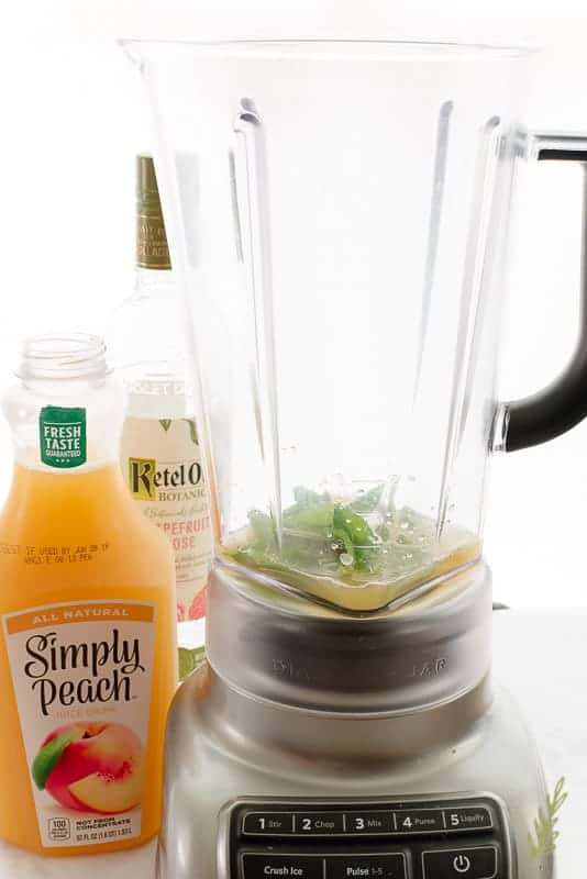 The blender with mint leaves and a little peach juice