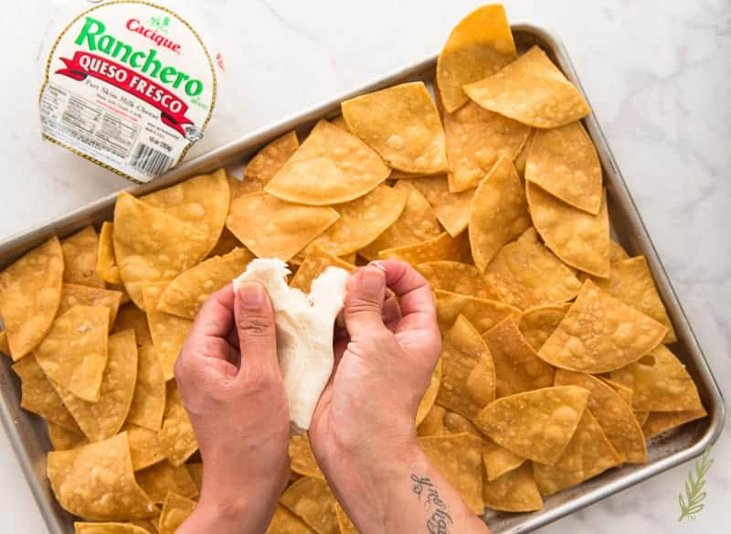 Tearing apart Oaxaca cheese to sprinkle on Chorizo and Egg Breakfast Nachos