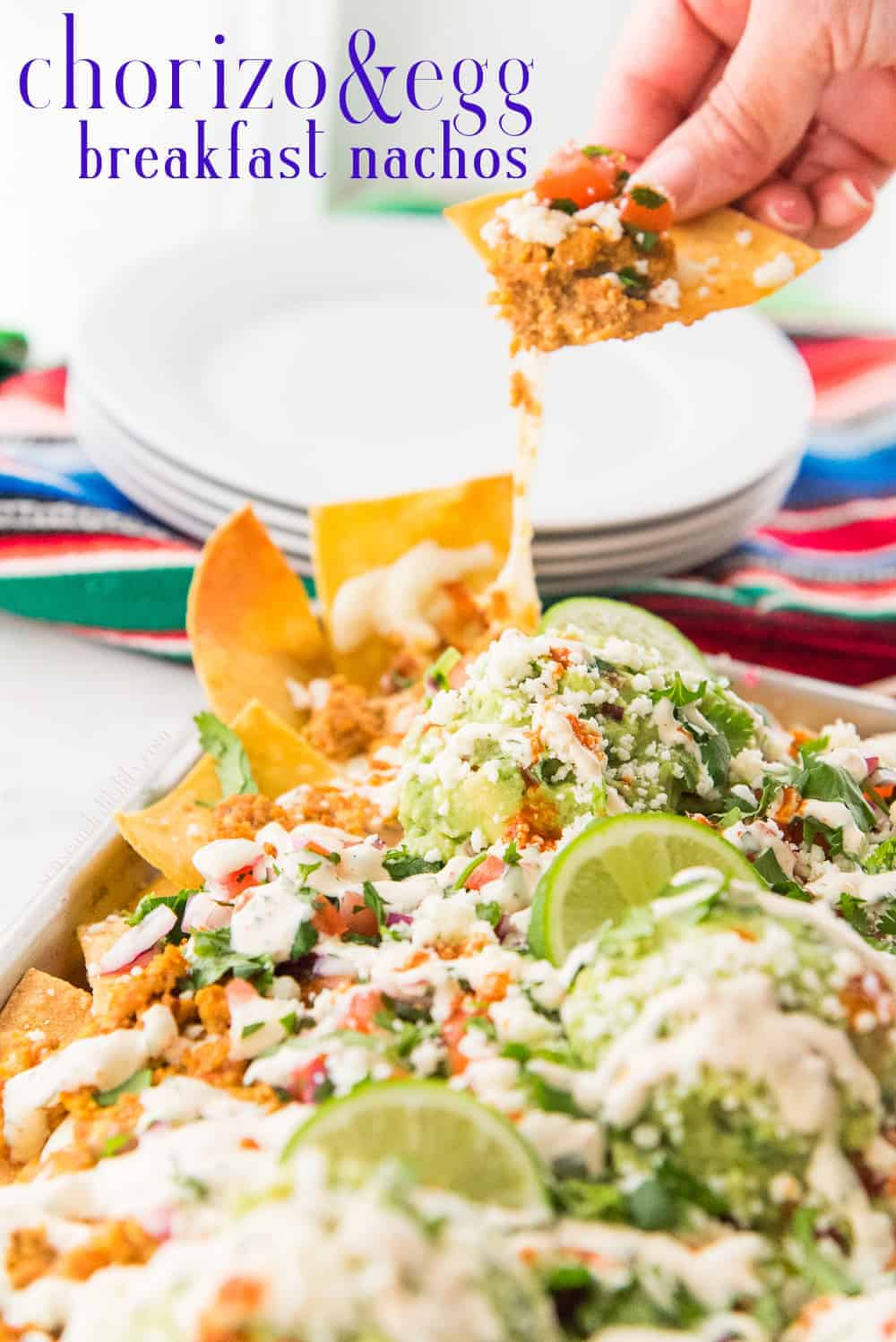 Chorizo and Egg Breakfast Nachos must be a regular part of your morning or brunch routines. Made with Mexican chorizo and freshly fried corn tortilla chips, you'll shock yourself at how easy and delicious this unique recipe is. #chorizo #Mexicanchorizo #breakfastnachos #brunch #breakfast #kidfriendly #morning #nachorecipe #corntortillas #picodegallo #guacamole #recetasdenacho #PuertoRicanrecipewriter #sheetpanmeals via @ediblesense