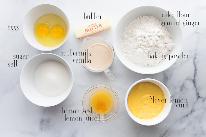 Ingredients needed to make Lemon Meringue Cupcakes: eggs, butter, flour, baking powder, ground ginger, lemon curd, lemons, buttermilk, vanilla, and sugar