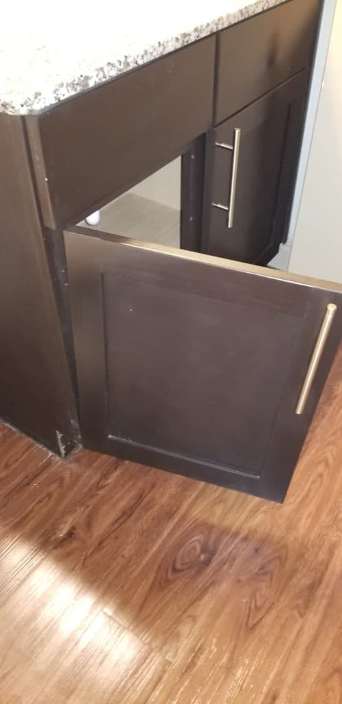 "(Not so) Sturdy cabinet door in our ""new"" San Antonio townhome."