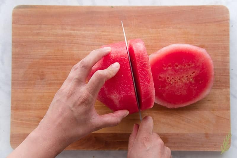 Slicing the watermelon for the salad