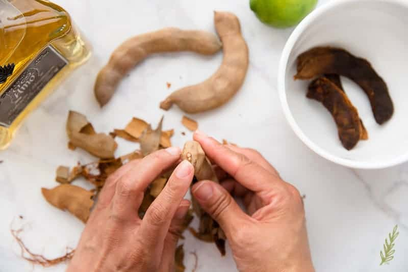 Be sure to keep the stem end of the tamarind pod in tact