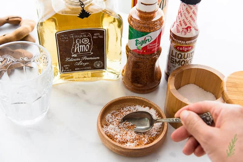 mixing the smoked spice mixture in a wooden prep bowl