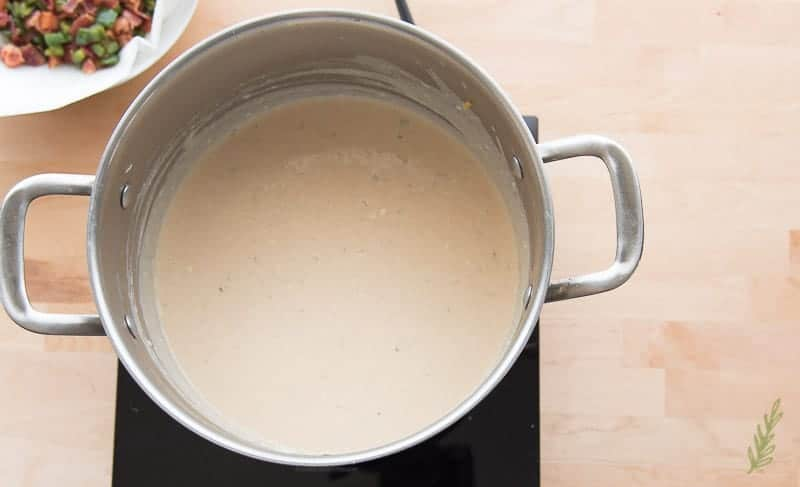 The finished mornay (cheese) sauce in the stock pot.