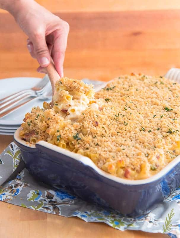 Spooning the mac and cheese from the casserole dish