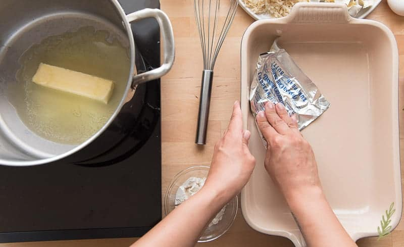 Buttering the casserole dish with the Danish Creamery wrapper