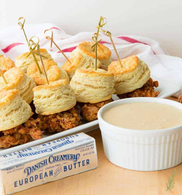 Platter of chicken and biscuits with maple-butter dipping sauce and stick of Danish Creamery butter