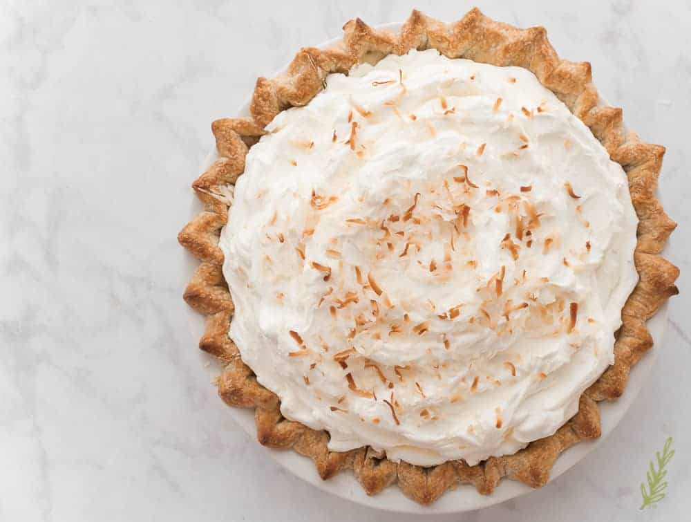 The overhead (finished) pie with whipped cream and toasted coconut