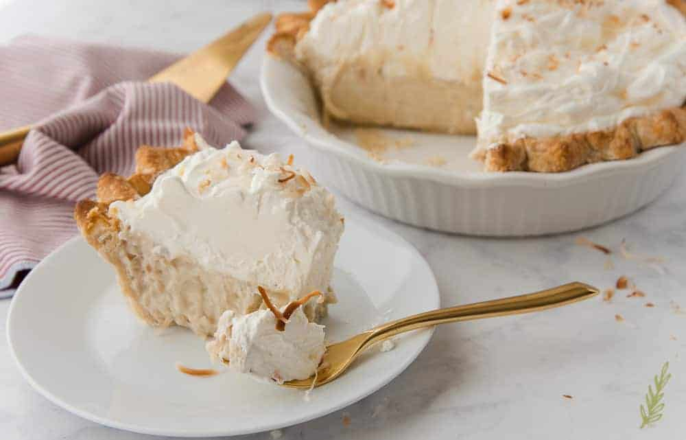 Close up of a forkful of Coconut Rum Cream Pie