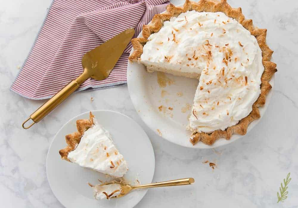 Coconut Rum Cream Pie with slice removed
