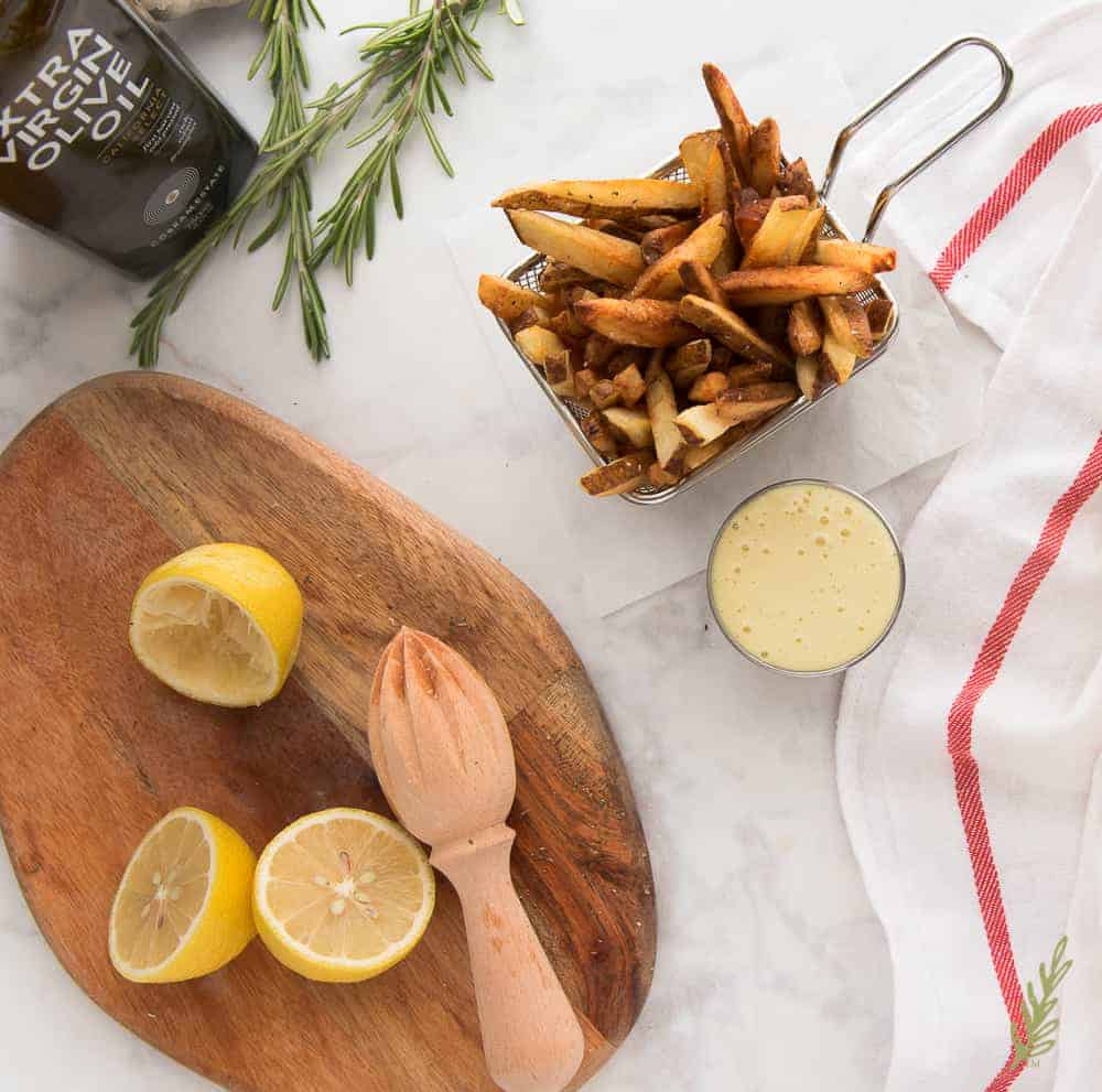 Overhead shot of a basket of French Fries with Rosemary and Lemon Aioli