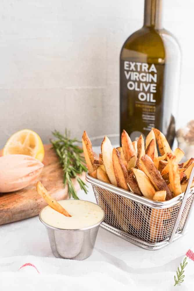 basket of French fries with one fry in the dip