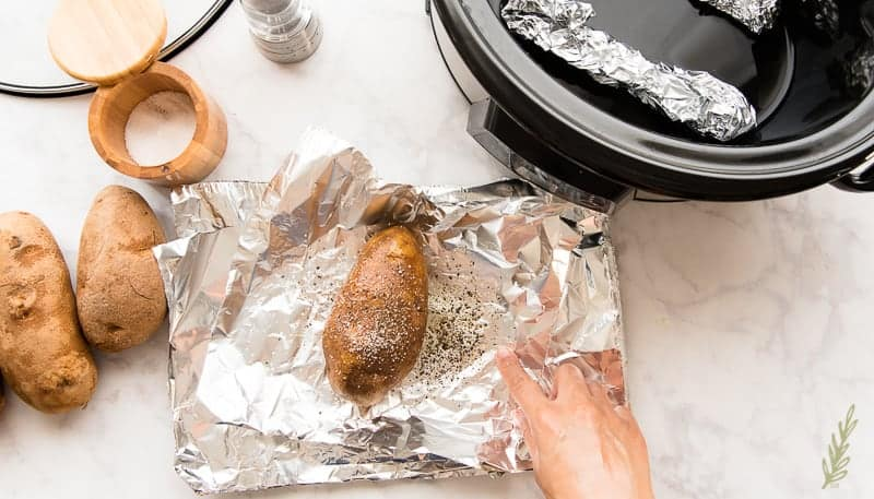 Liberally season the oiled potatoes before wrapping in foil