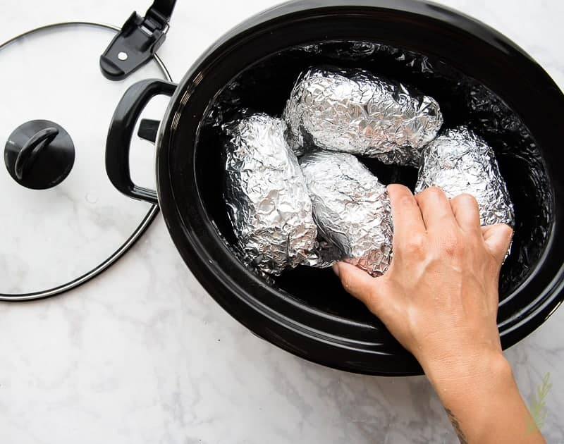 Arrange the foil-wrapped potatoes in a single layer