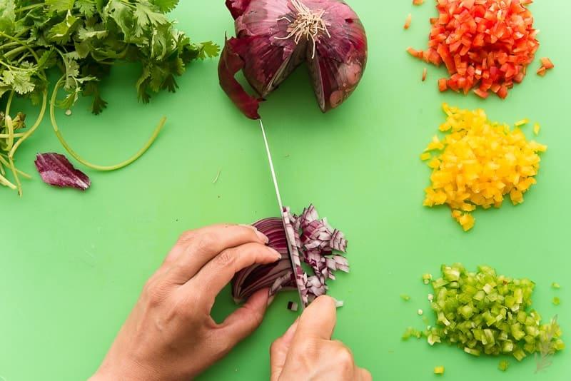Prep the veggies used in the Western Omelet