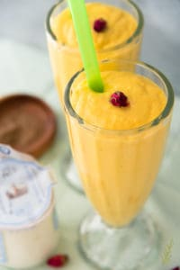 Closeup (three-quarter shot) of a glass of Mango Lassi