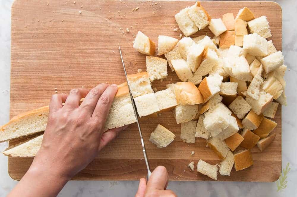 Cutting the bread into cubes