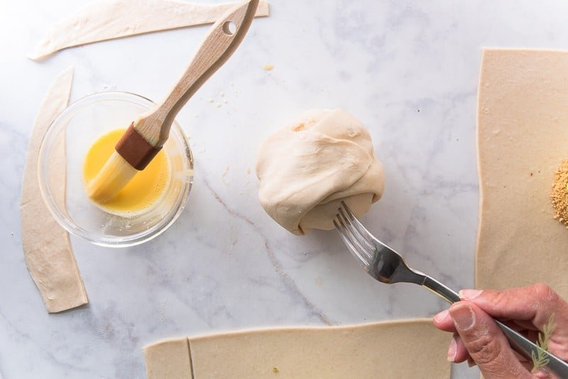 Use a fork to pierce the puff pastry shell to allow steam to escape