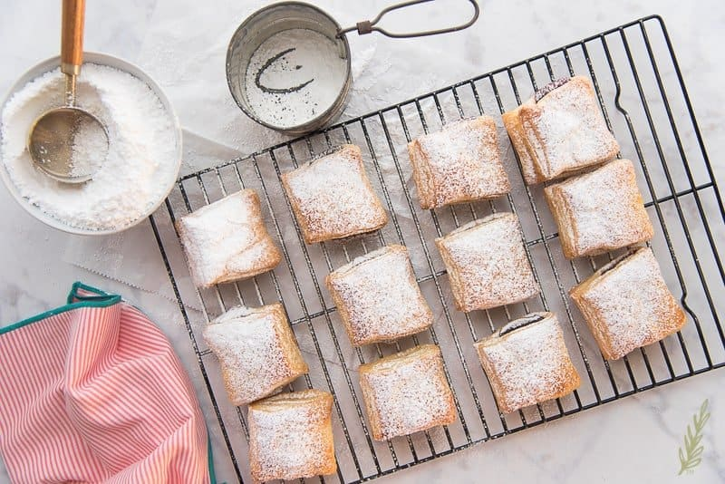 Sprinkled guava turnovers on a cooling rack