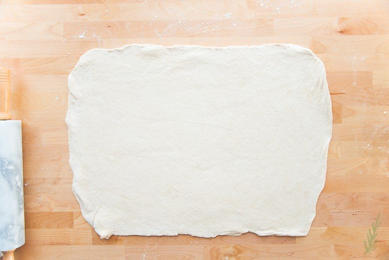 Roll the dough out to a large rectangle
