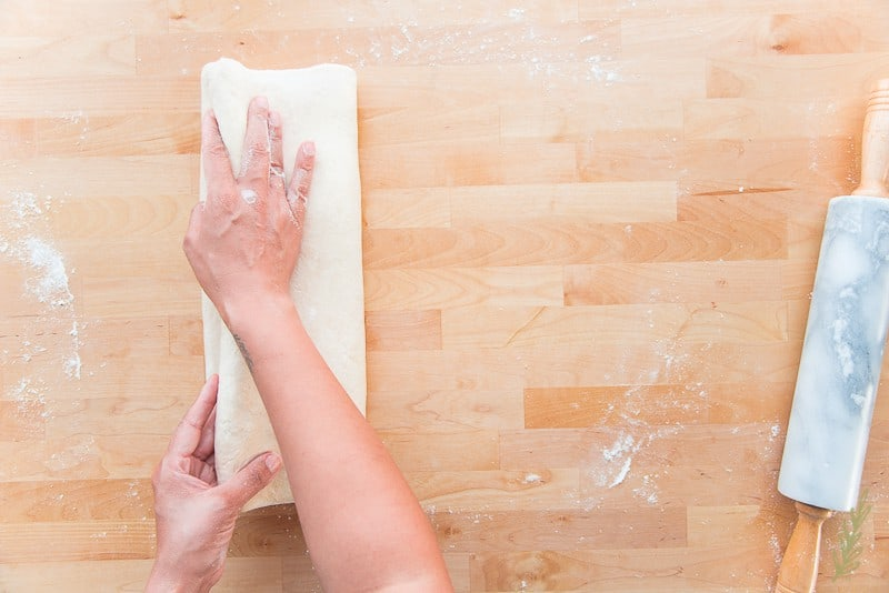 Complete the fourth and final fold in your puff pastry first four-fold turn