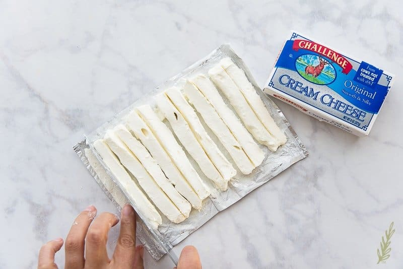 Cut the brick of cream cheese into 12 long sticks