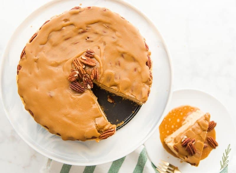 An overhead shot of the finished and sliced Sweet Potato Cheesecake with Pecan Praline Topping
