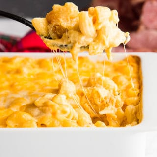 A cheesy scoop of Five Cheese Baked Macaroni and Cheese