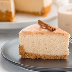 A slice of Creamy Coquito Cheesecake ready to enjoy