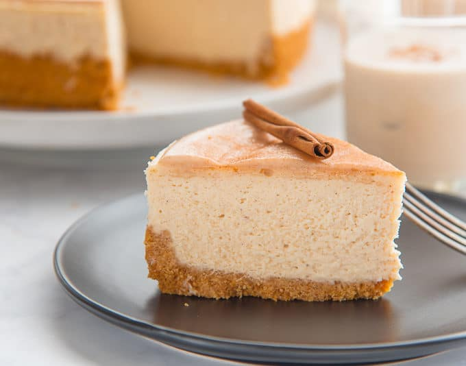 A slice of Creamy Coquito Cheesecake ready to enjoy