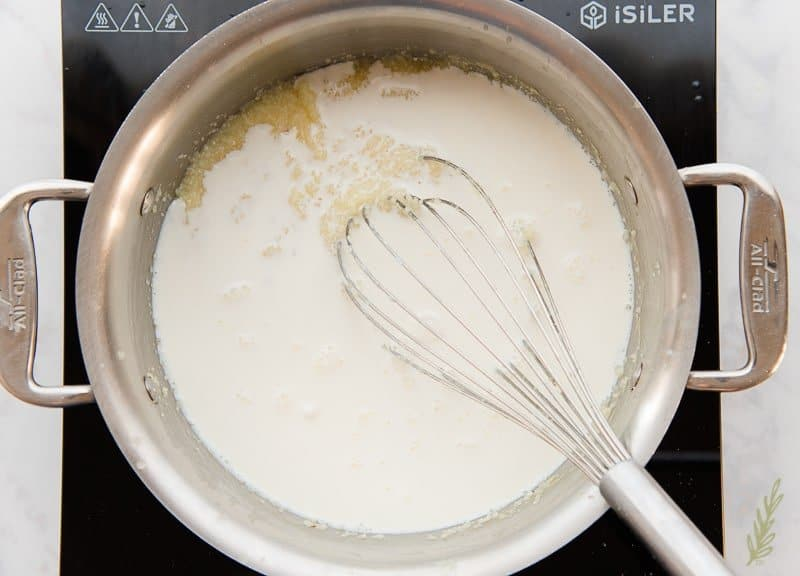 Add the half-and-half to the pot with the grits