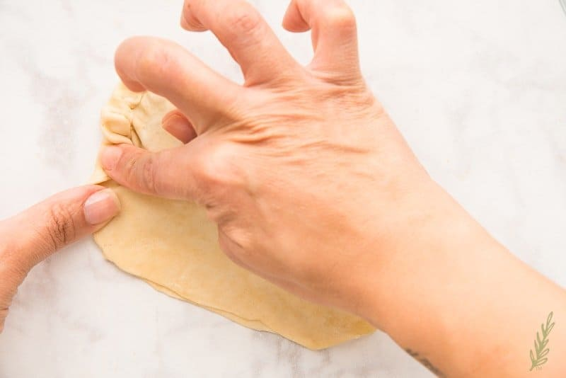 Crimp the edge of the empanada shell with your fingers