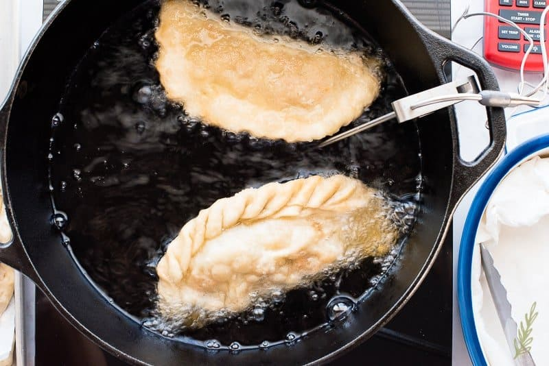The empanadas will rise to the top of the oil