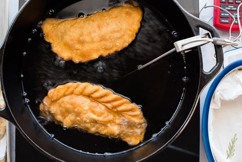 After 5 minutes, carefully remove the Pork Picadillo Empanadas from the oil