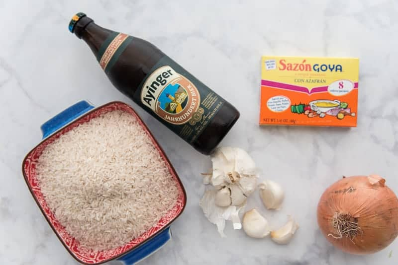 The ingredients needed for Arroz Borracho or Beer Steamed Rice