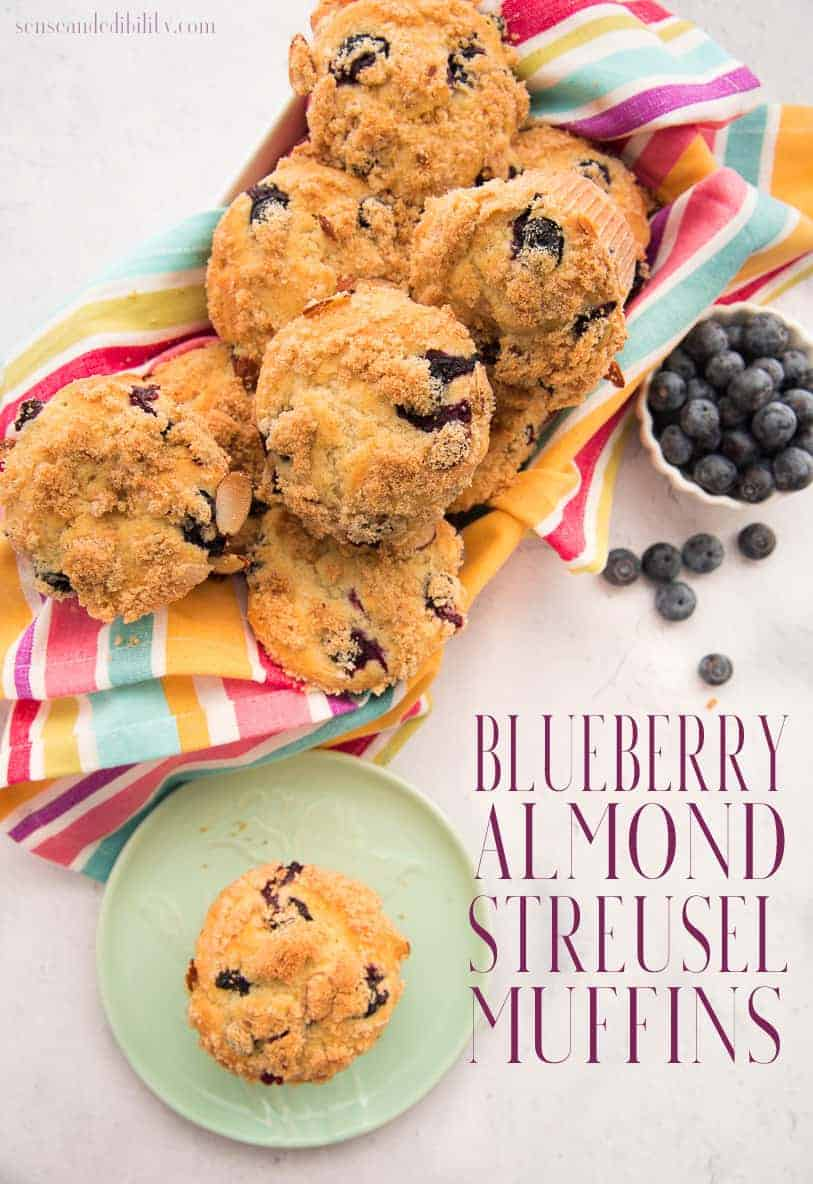 Crumbly Almond Streusel tops these buttery rich coffee cake Blueberry Muffins and creates the best morning meal. #blueberrymuffins #breakfast #muffins #streusel #quickbread #coffeecake #senseandedibility